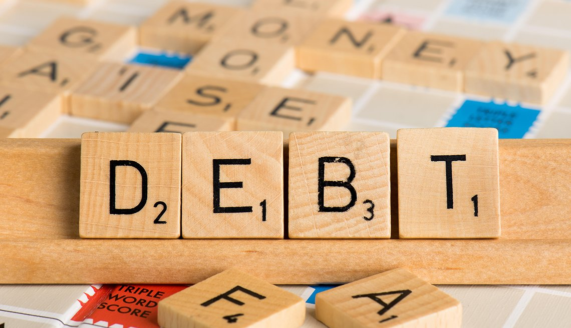 Scrabble letters spell out the word debt