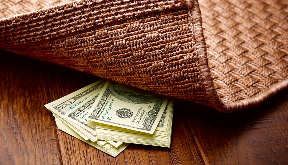 Money hidden under a rug