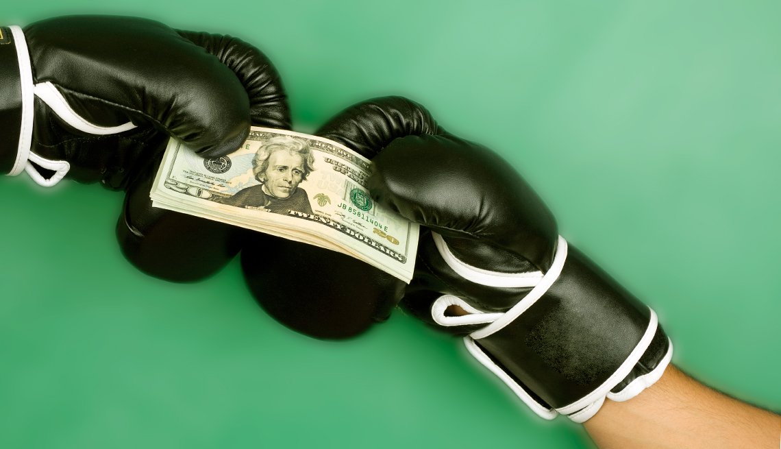 money and boxing gloves