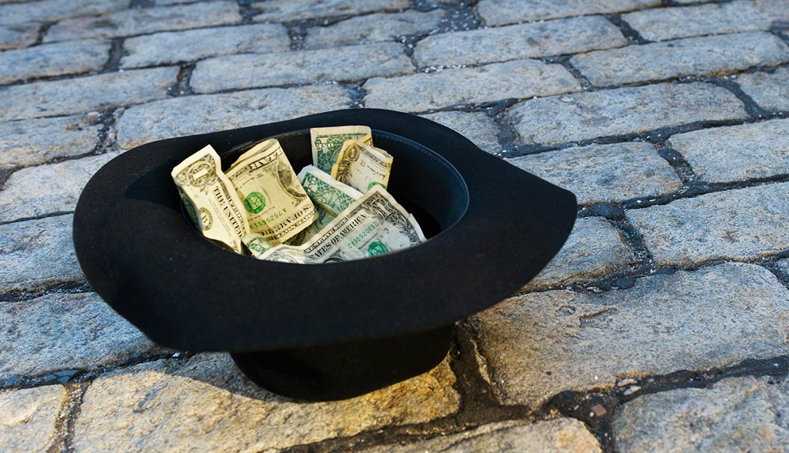 begger's hat with money inside