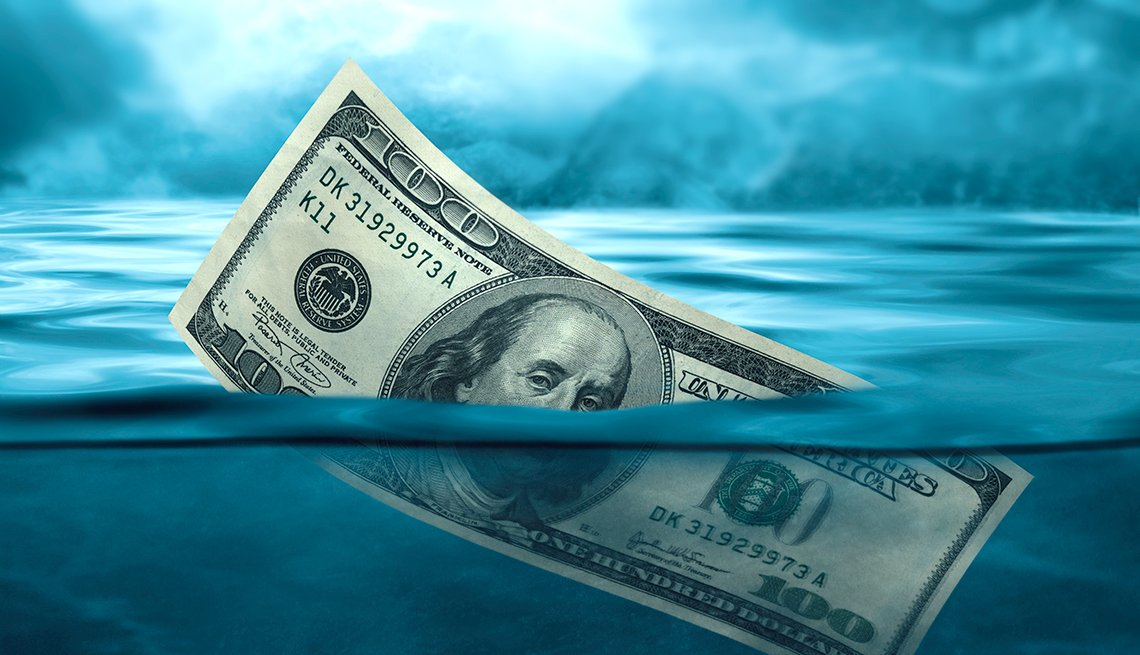 a $100 bill half underwater