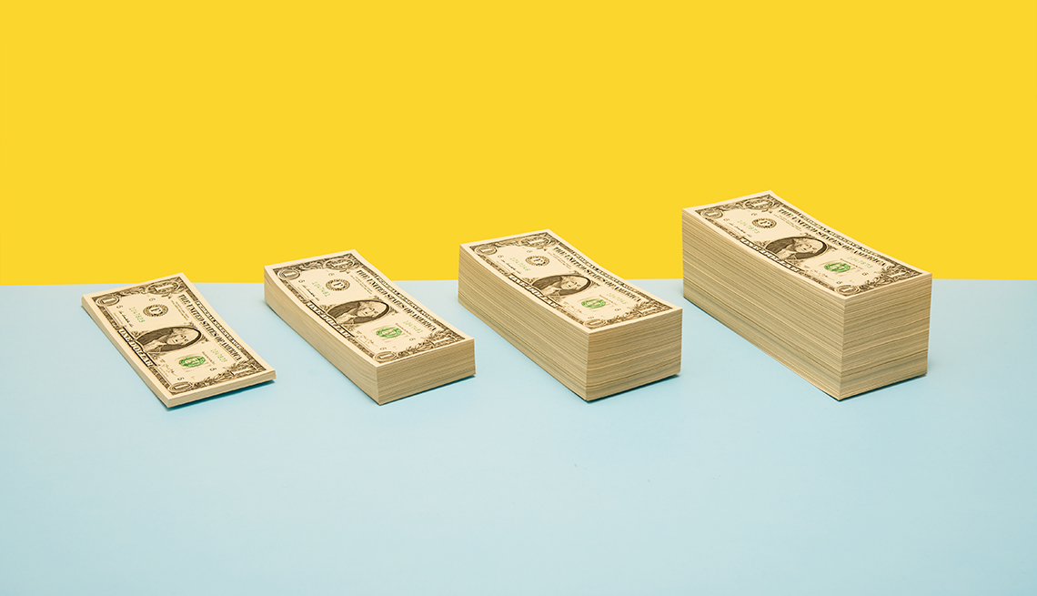 Four stacks of money growing progressively larger