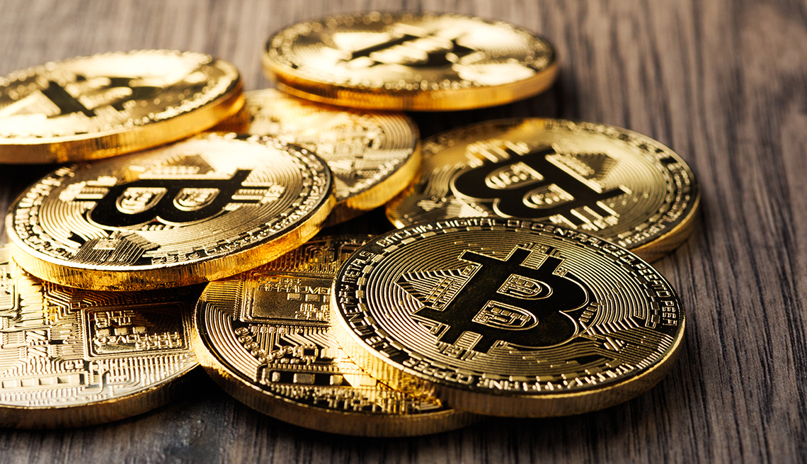 item 3 of Gallery image - Bitcoins on a table