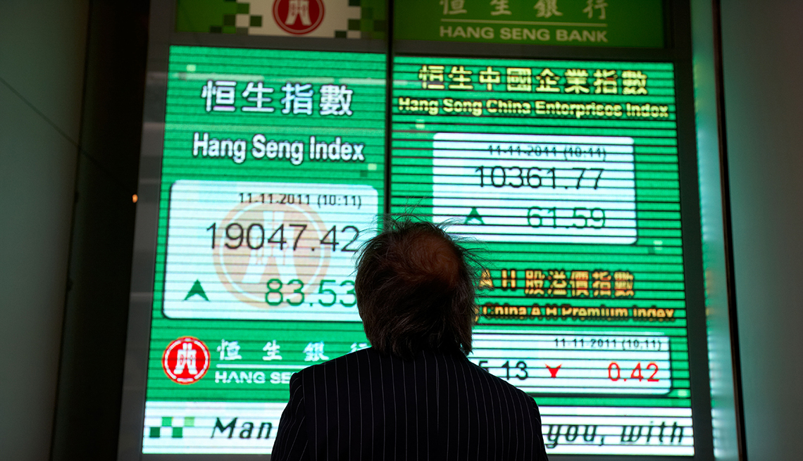 item 5 of Gallery image - Man looking at China's stock exchange
