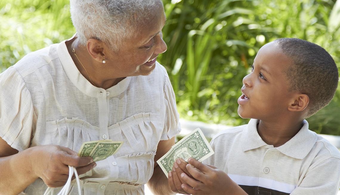 Grandma handing her grandson money