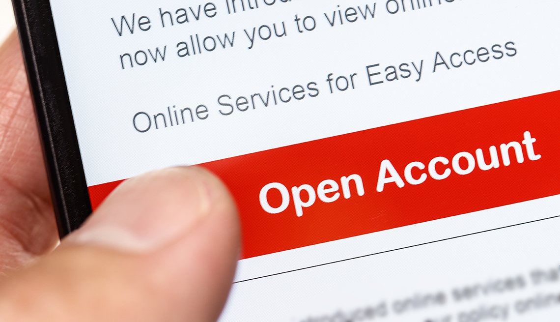 closeup of someone using a mobile phone to open an online bank account
