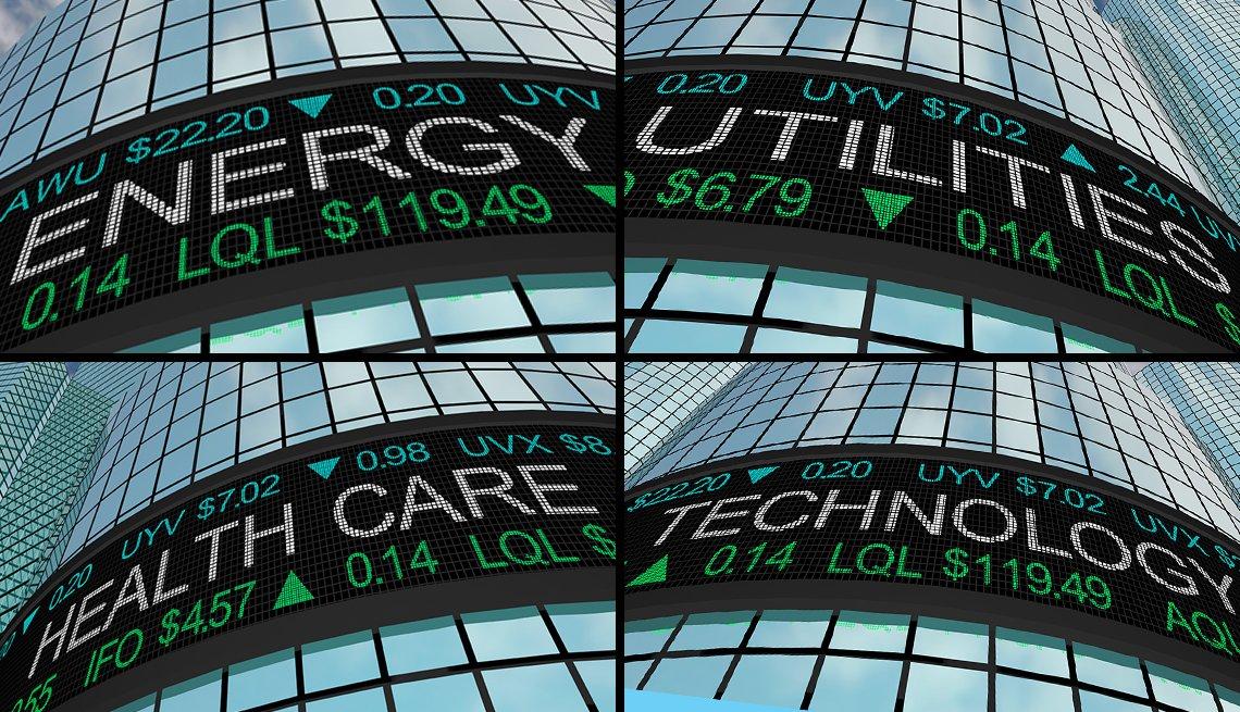 Letreros afuera de un edificio que muestran las cifras del mercado de valores de Wall Street