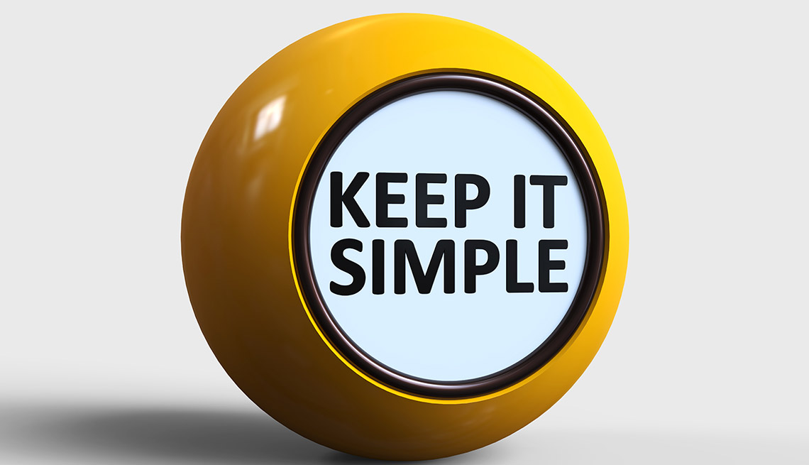 shiny yellow ball with the message Keep It Simple in black font on white facing