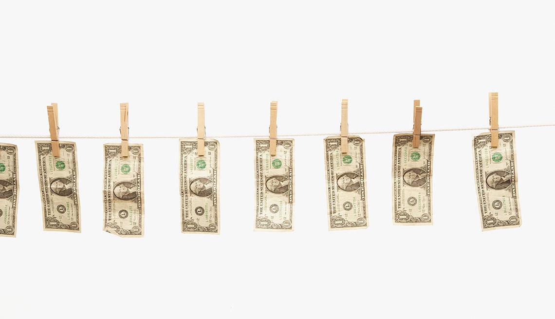 Dollar bills hanging on clothes line