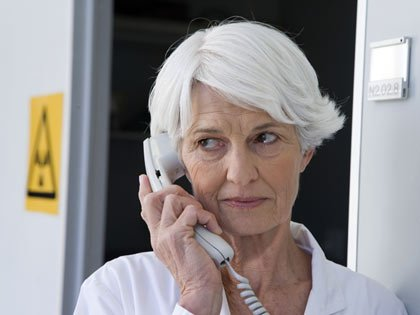 confused senior woman on the phone