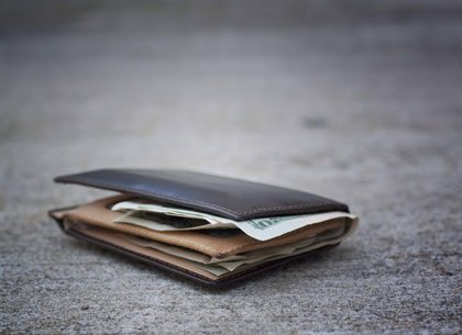 wallet on pavement