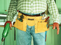 How to avoid handyman contracting scams-contractor with toolbelt