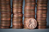 Piles of pennies--AARP Scam Alert on risks of online penny auctions