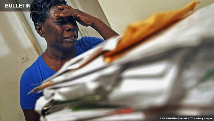 African American woman crying over home foreclosure scam - Some con artists get you sign title of your home to them.