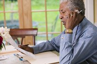 Man on phone-AARP investment fraud hotline