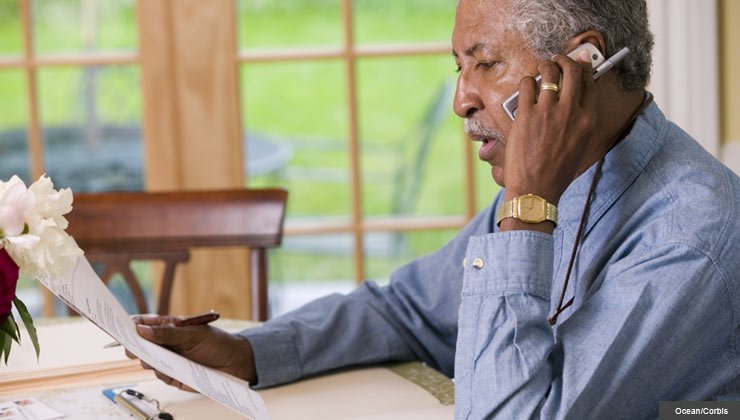 Man on phone-AARP investment fraud hotline