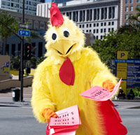 person in chicken suit handing out flyers