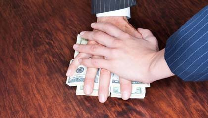 AARP's book Outsmarting the Scam Artists offers practical advice for protection- men's hands with money