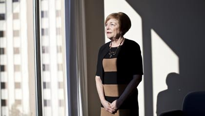 woman standing by window, Peggy Friedenberg backs efforts to protect people from financial abuse
