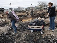 Residents clean up damage from Hurricane Sandy.