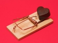 Chocolate heart in trap, Valentine's Day scams