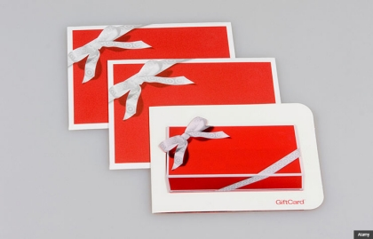 Red gift cards with ribbons. Holiday scam alert. (Alamy)