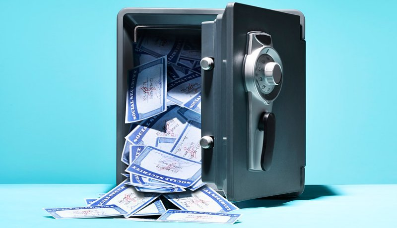 Social Security cards spilling out of open safe