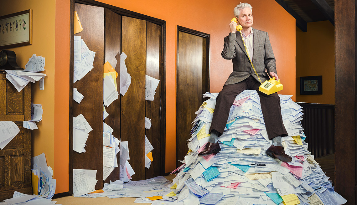 What's Bugging You - Ron Burley sitting on the pile of paper on the phone