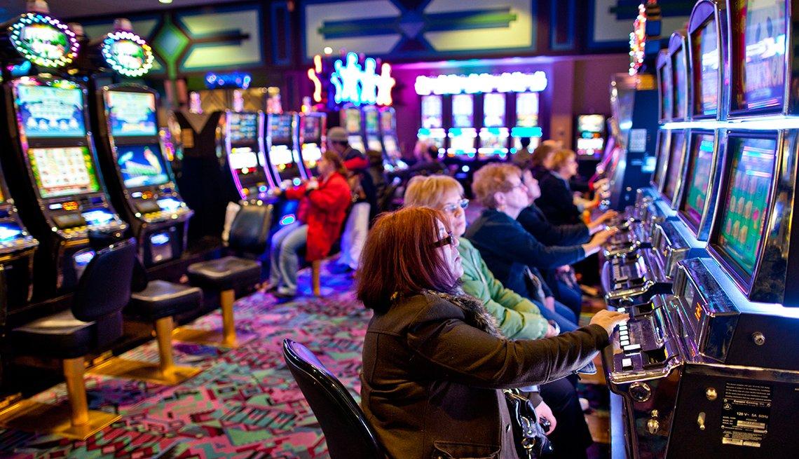 Gamblers play on a casino floor
