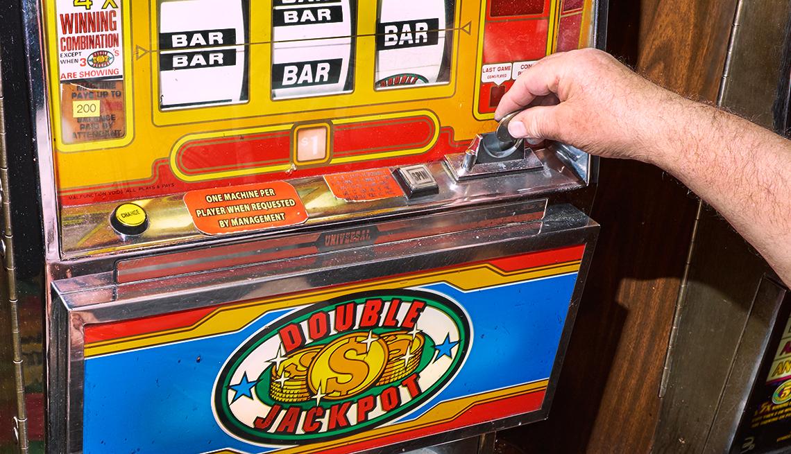 A gambler plays a slot machine at a casino