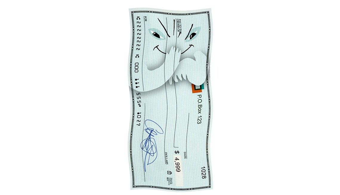 Imagen de un cheque con una cara de maldad, y cuidado con los cheques falsos.