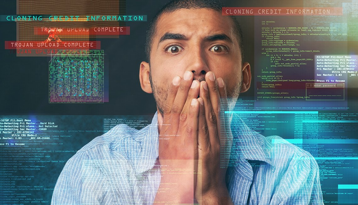 Hombre con las manos en la cara frente a una pantalla con datos