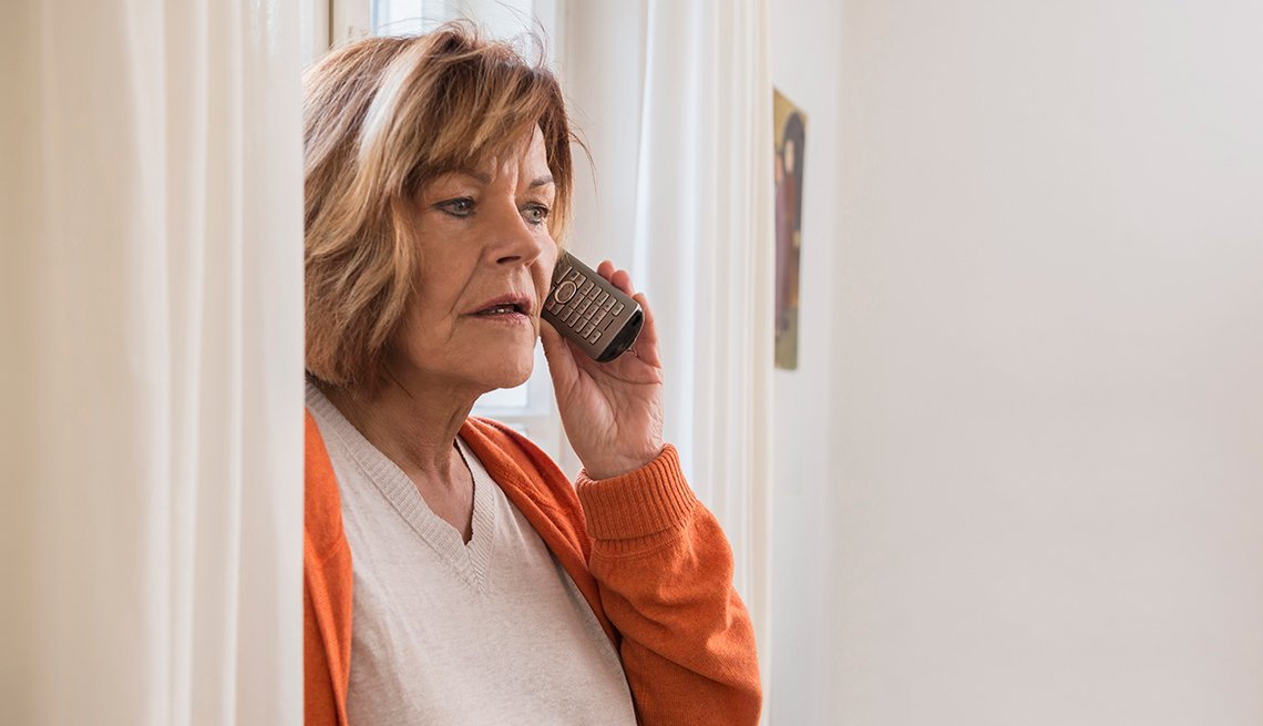 Concerned woman on house phone