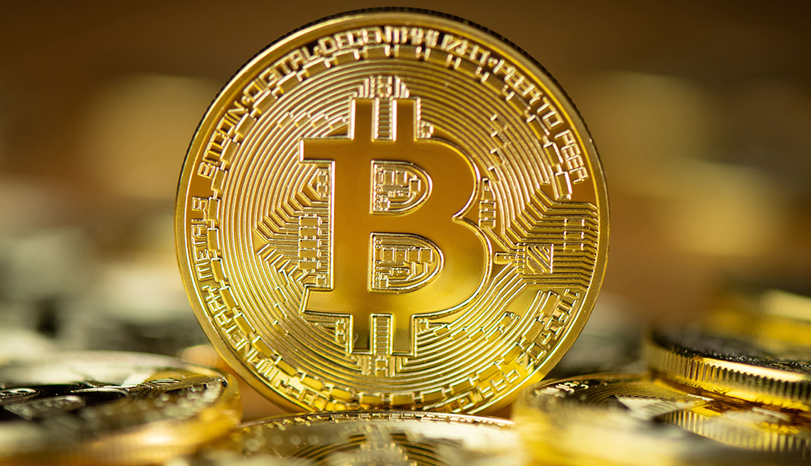 A gold coin with the letter Bi as a visual representation of the digital cryptocurrency, Bitcoin.