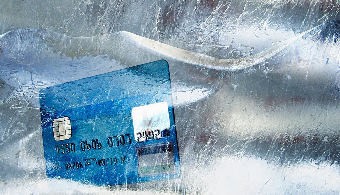 Credit card in frozen block of ice