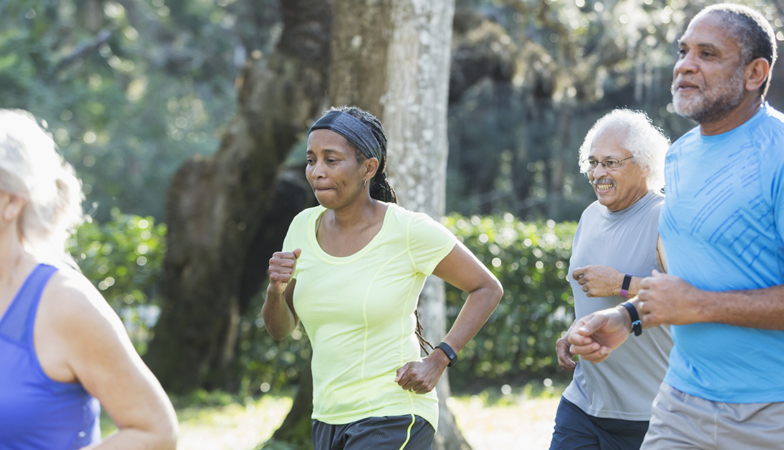 item 15 of Gallery image - Group of people running and wearing fitness trackers