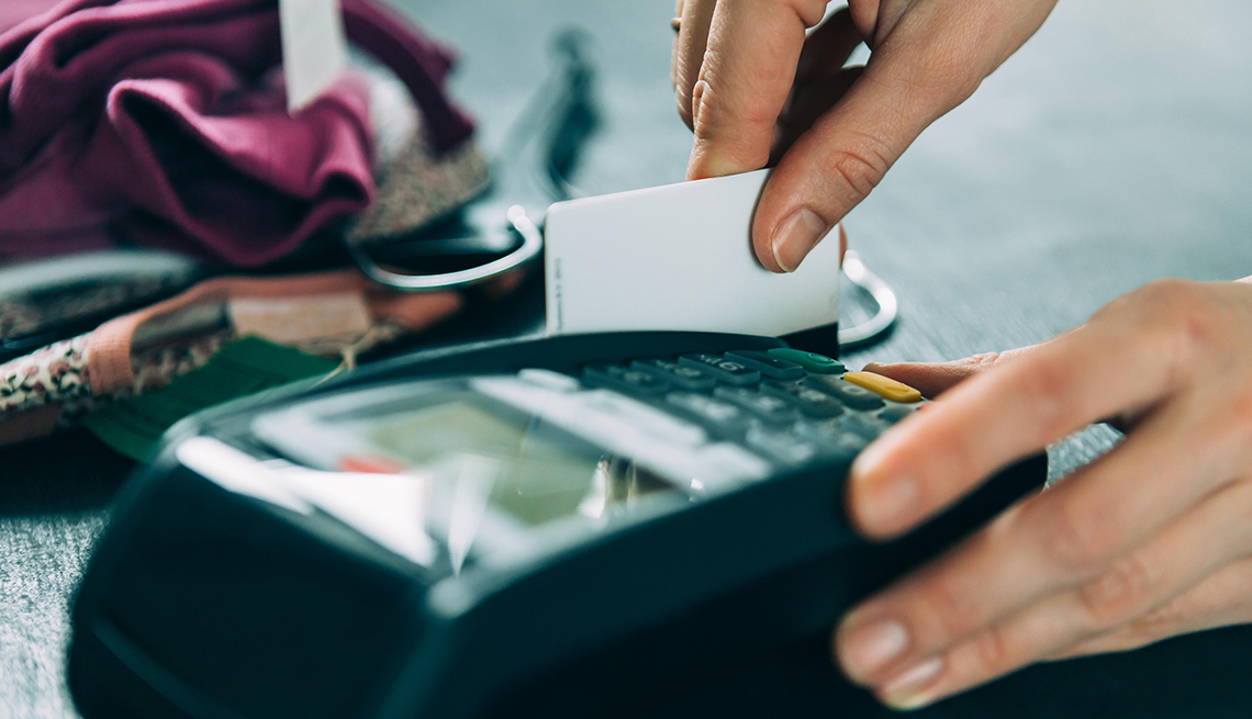 item 11 of Gallery image - Woman using a credit card