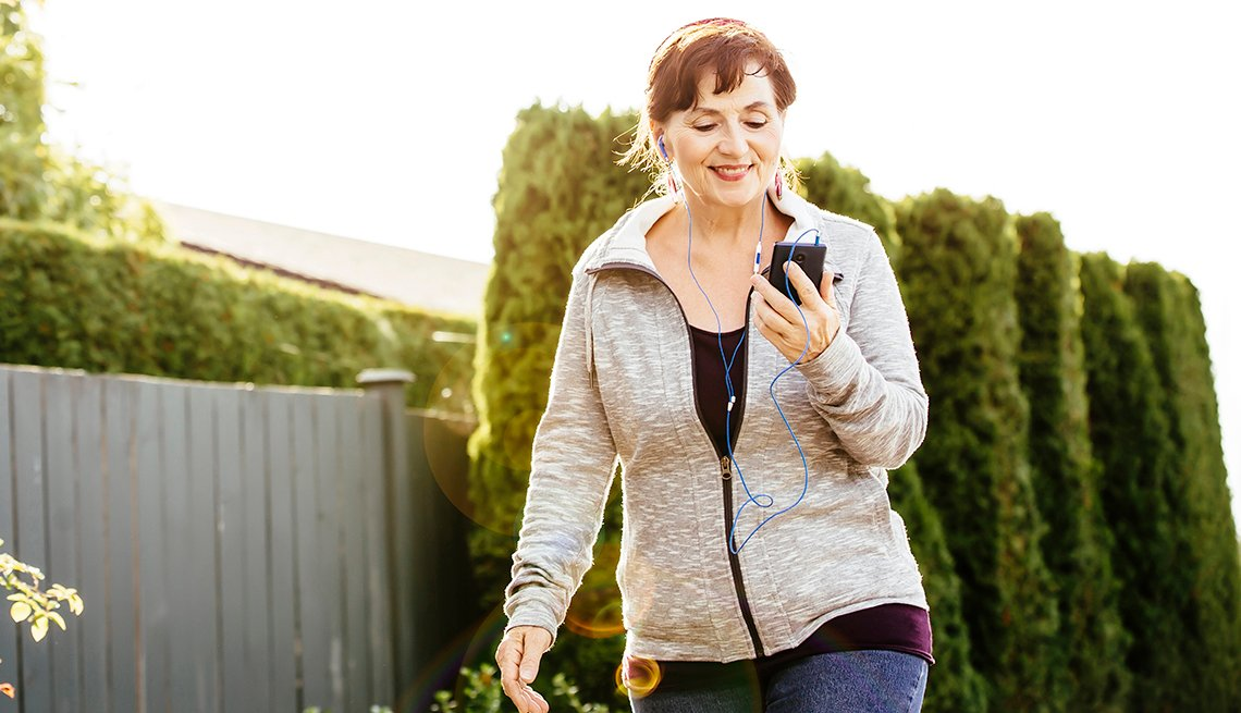 item 16, Gallery image. Caucasian woman using cell phone outdoors