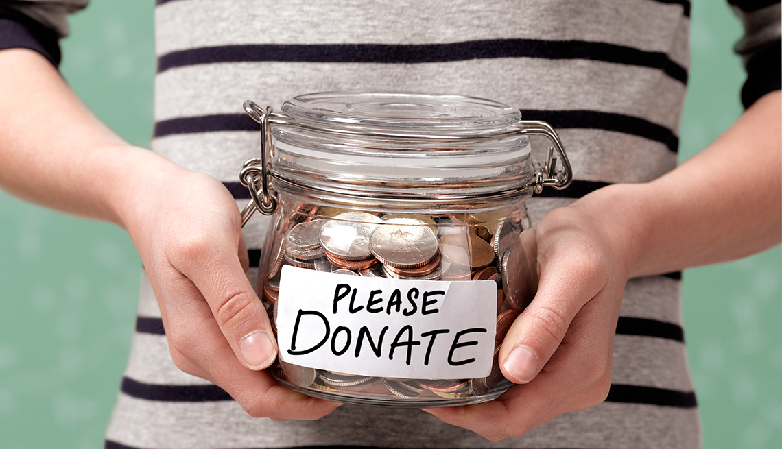 Person holding a donation jar