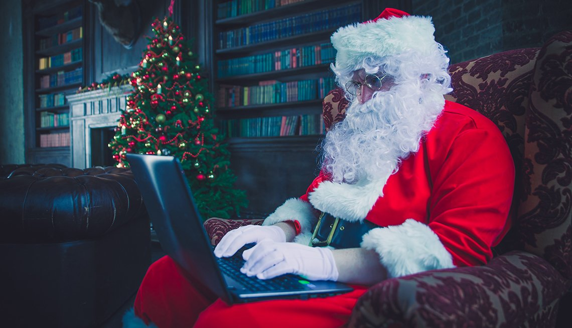 Person in Santa costume on a computer
