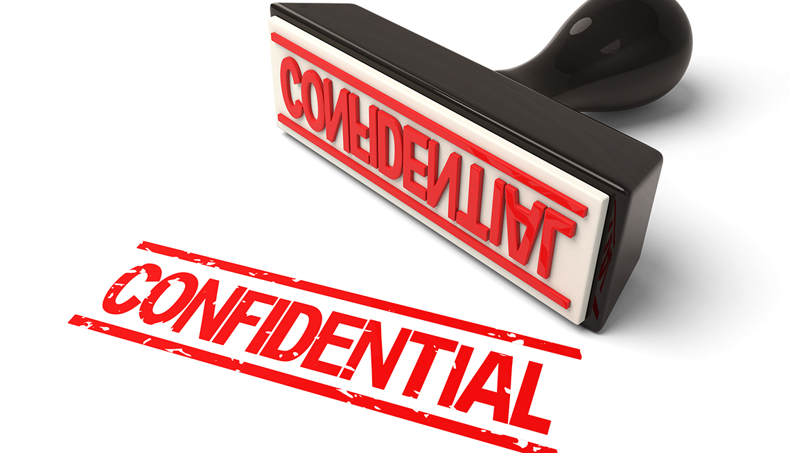 """A rubber stamp with """"Confidential"""" in red ink.3d image. Isolated white background."""