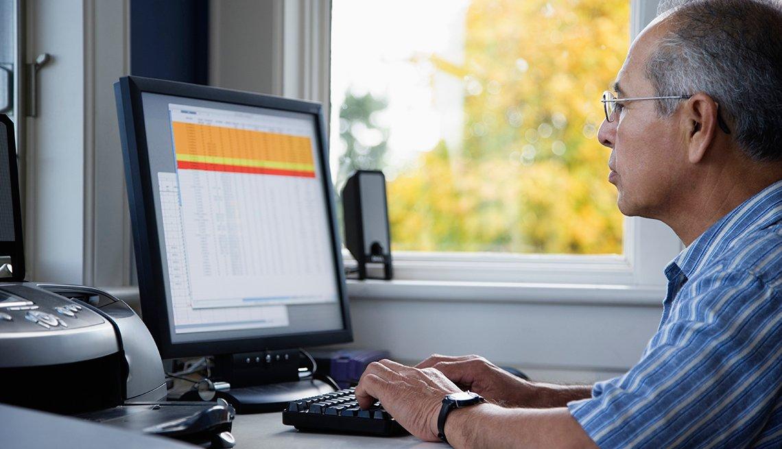 Man sitting looking at his computer screen