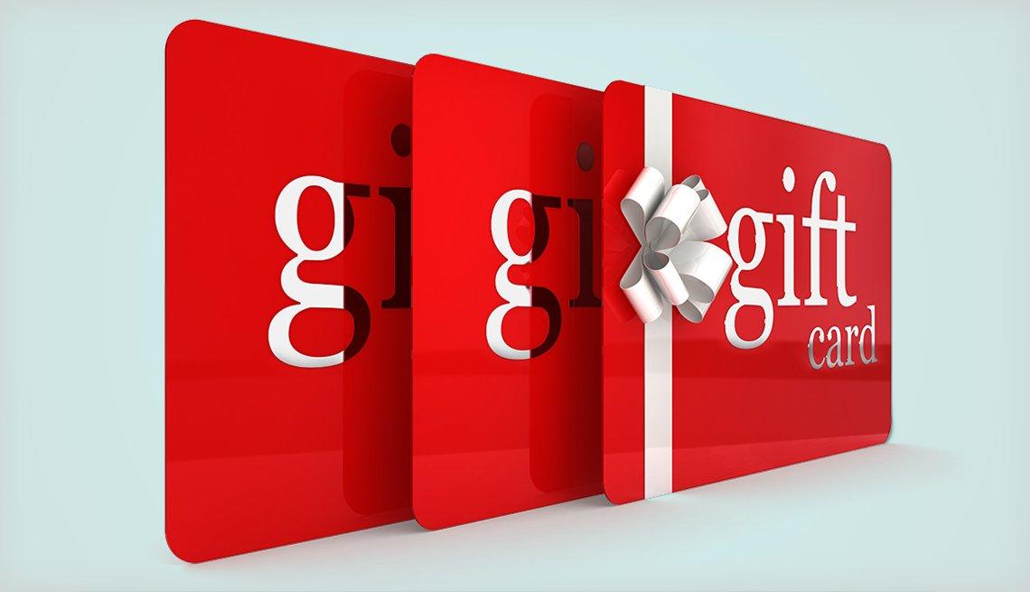 Tres tarjetas de regalo de color rojo con una cinta que termina en moño.
