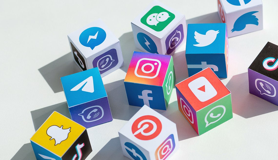 Social media icon logos on paper cubes
