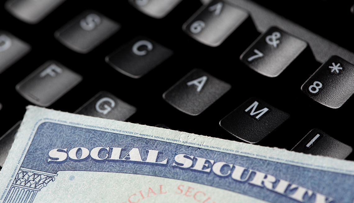 A social security card in a black keyboard