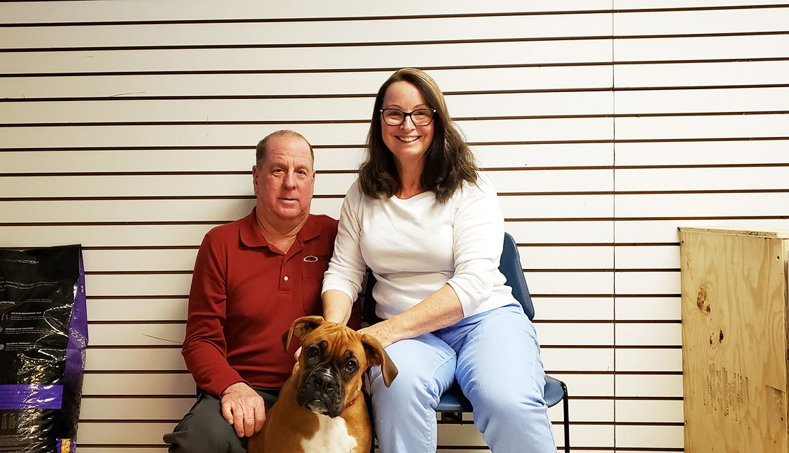 Karen and Joe Heyden and dog Heidi, purchased after the couple was scammed.