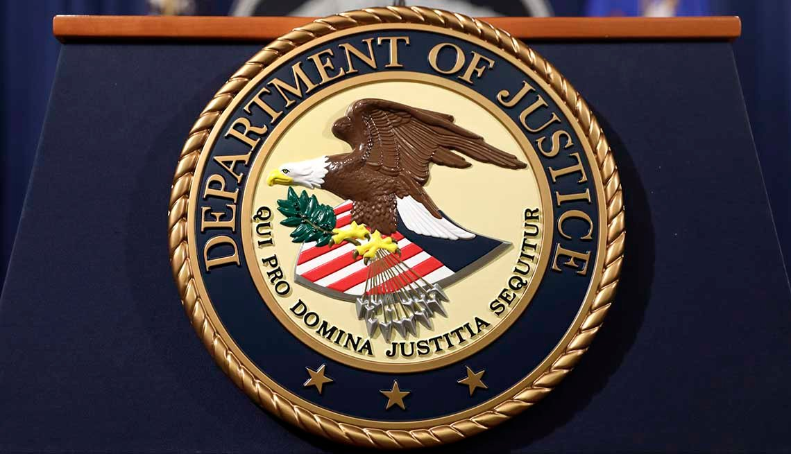 Department of Justice seal on a podium