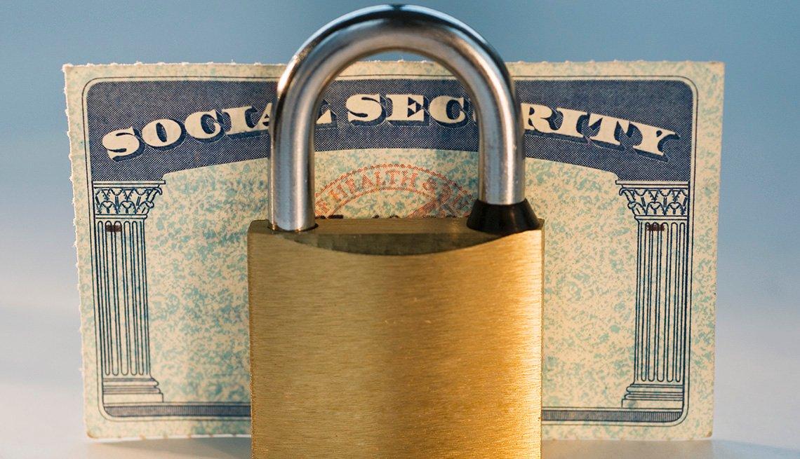 Social security card under lock concept