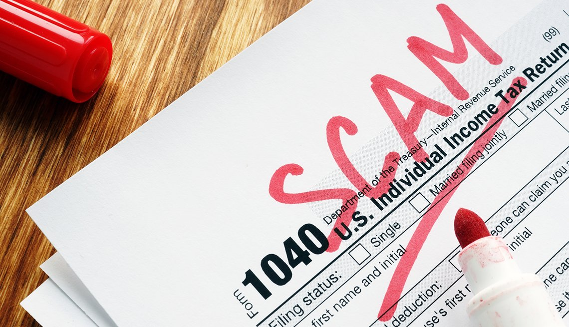 tax return form marked  as scam on a desk