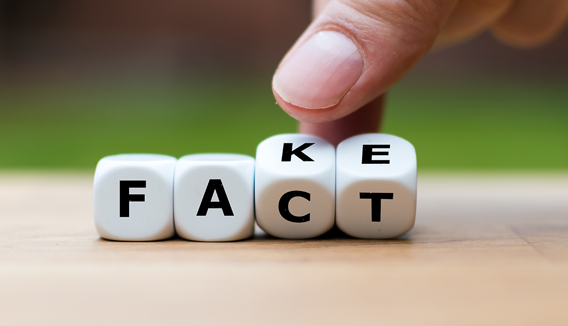 Fact vs Fake information concept with dice